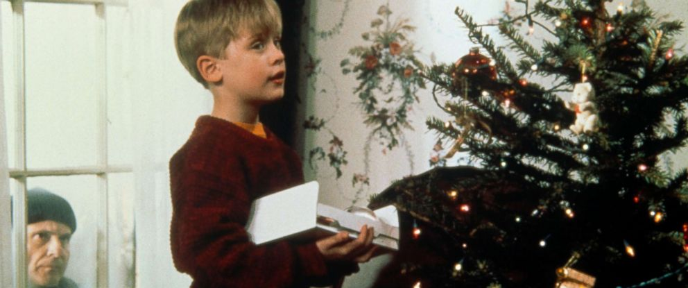 "PHOTO: Joe Pesci, left, as Harry Lime, peers through a window at Macaulay Culkin, as Kevin McCallister, as he decorates a Christmas tree in scene from ""Home Alone."""