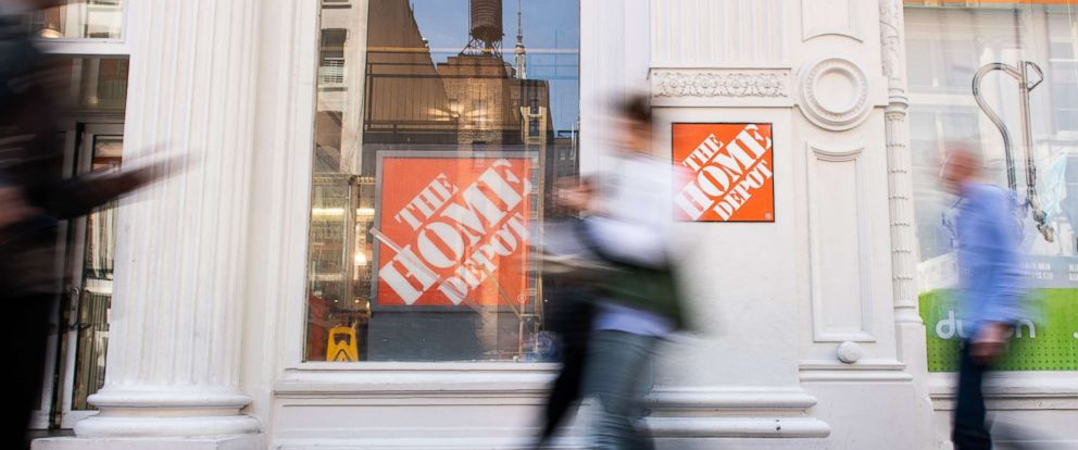 PHOTO: Pedestrians pass in front of a Home Depot Inc. store in New York, May 11, 2018.