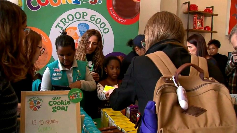 Members of Girl Scout Troop 6000, New York's first homeless shelter-based troop, hold their first cookie sale in Union Square, Manhattan in April 2018.