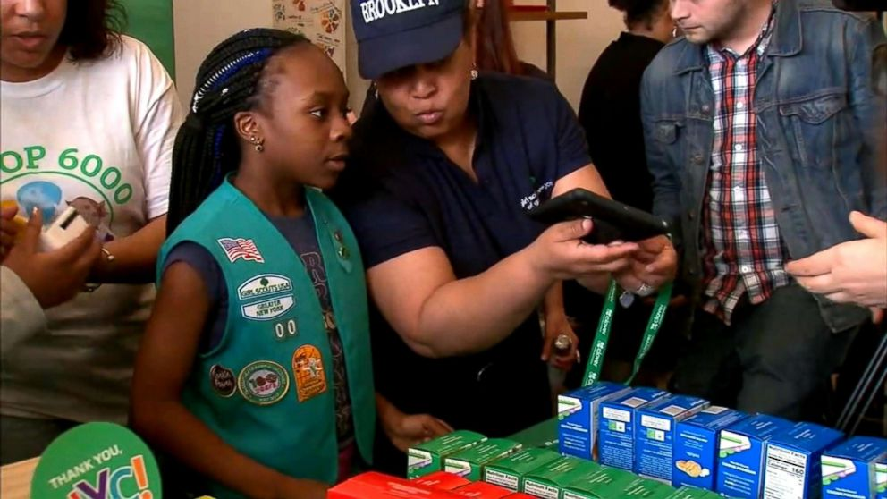 A member of Girl Scout Troop 6000, New York's first homeless shelter-based troop, participates in the troop's first cookie sale in Union Square, Manhattan in April 2018.
