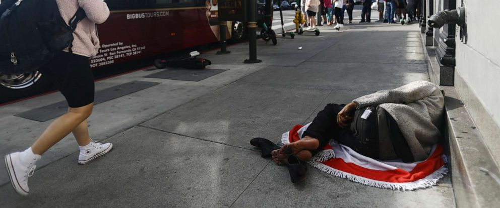 PHOTO: A man sleeps on the street near Hollywood Boulevard, June 6, 2019, in Los Angeles.