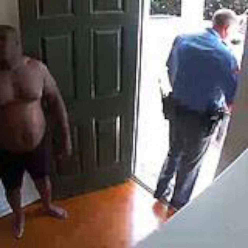 PHOTO: Security video shows Raleigh, North Carolina, homeowner Kazeem Oyeneyin, being returned to his home in just his underwear after he was handcuffed and placed in a police car when officers responded to a false burglary alarm on Aug. 17, 2019.