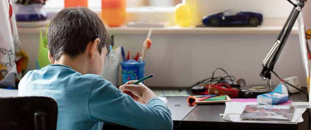 PHOTO: A young boy works on his homework in this undated stock photo.
