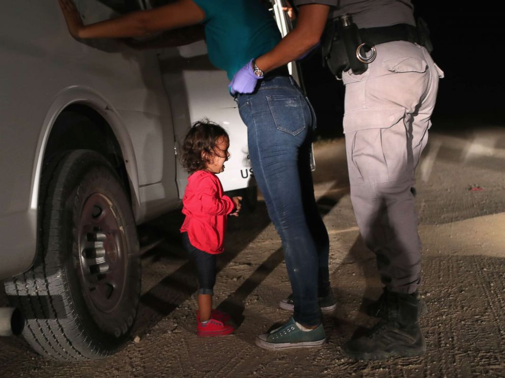 PHOTO: A two-year-old Honduran girl cries as her mother is searched and detained near the U.S.-Mexico border on June 12, 2018 in McAllen, Texas.