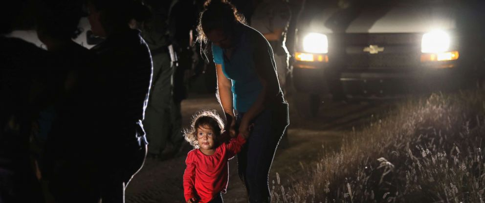 PHOTO: A two-year-old Honduran stands with her mother after being detained by U.S. Border Patrol agents near the U.S.-Mexico border on June 12, 2018 in McAllen, Texas.