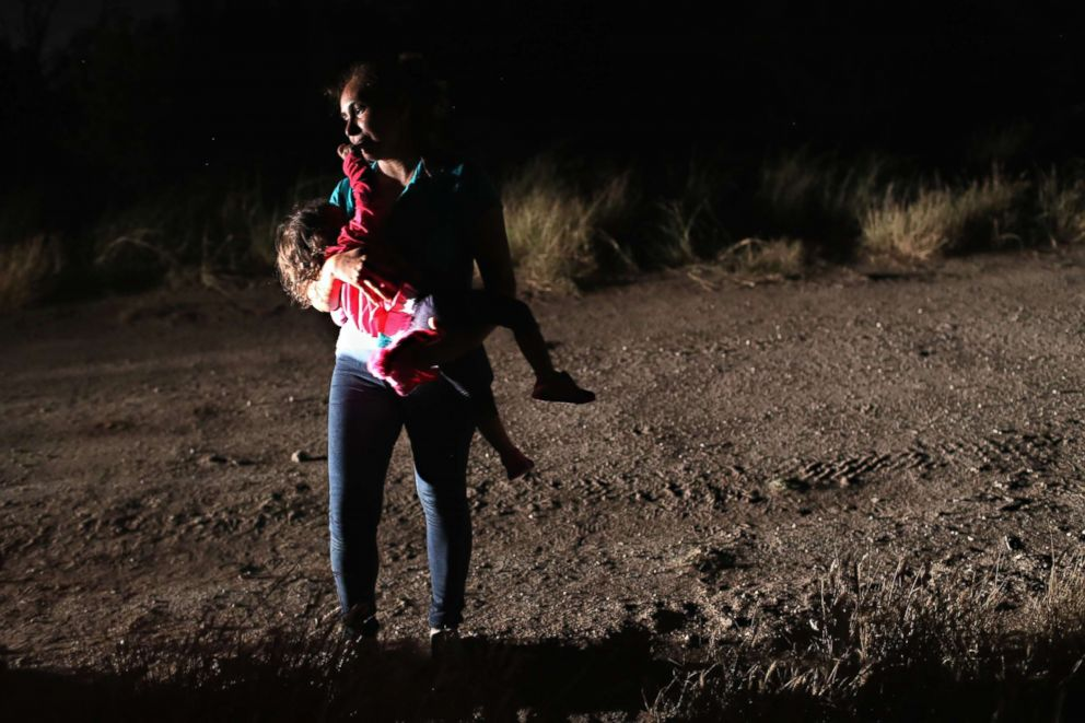 A Honduran mother holds her two-year-old daughter while being detained by U.S. Border Patrol agents near the U.S.-Mexico border on June 12, 2018, in McAllen, Texas. The asylum seekers had rafted across the Rio Grande from Mexico and were detained before being sent to a processing center for possible separation.