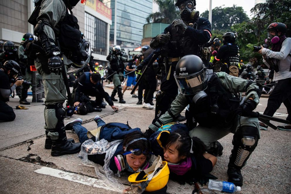 PHOTO: Riot police detain demonstrators during a protest in the Admiralty district of Hong Kong, China, on Sunday, Sept. 29, 2019.