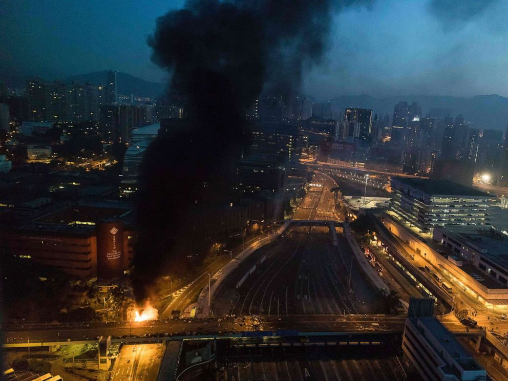 PHOTO: Smoke billows from a fire next to Hong Kong Polytechnic University and the road leading to the Cross Harbour Tunnel in Hung Hom district of Hong Kong on Nov. 18, 2019.