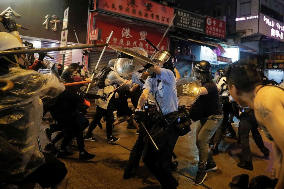 PHOTO: Policemen clash with demonstrators on a street during a protest in Hong Kong, Aug. 25, 2019.