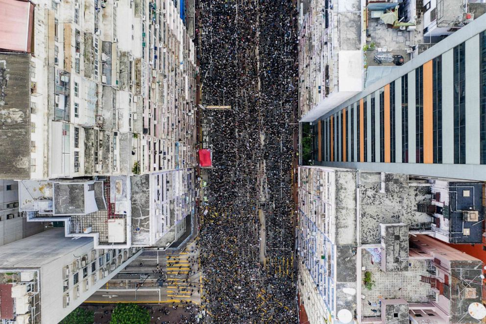 PHOTO: Thousands of protesters march through the street as they take part in a new rally against a controversial extradition law proposal in Hong Kong, June 16, 2019.