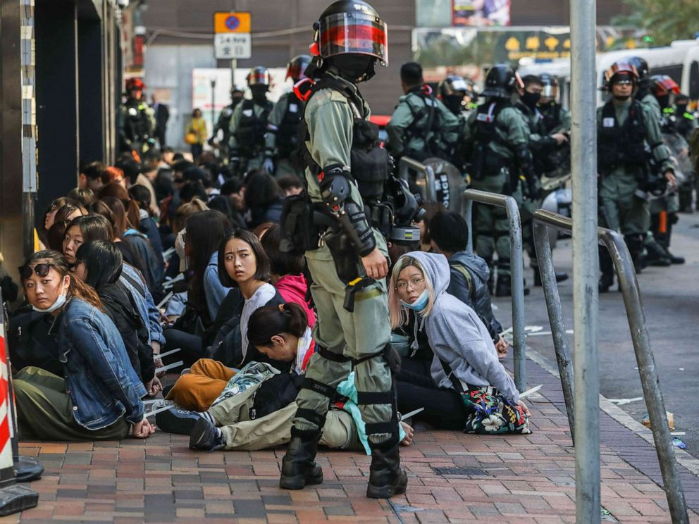 PHOTO: People are detained by police near the Hong Kong Polytechnic University in Hung Hom district of Hong Kong on Nov. 18, 2019.