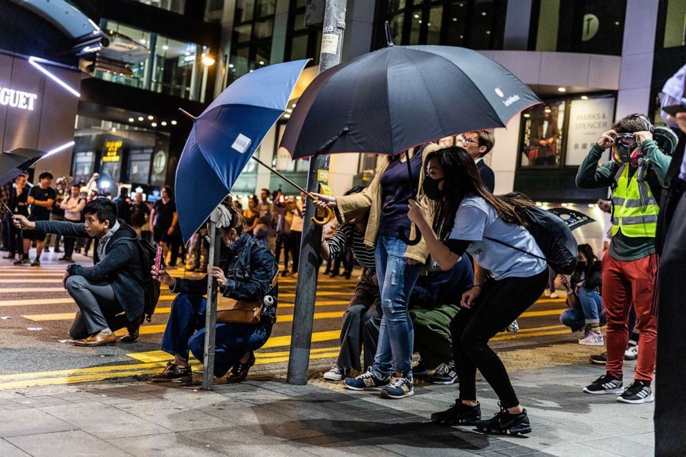 PHOTO: Protesters open umbrellas in fear of the police shooting during anti-government protests in Hong Kong, China, Nov. 12, 2019.