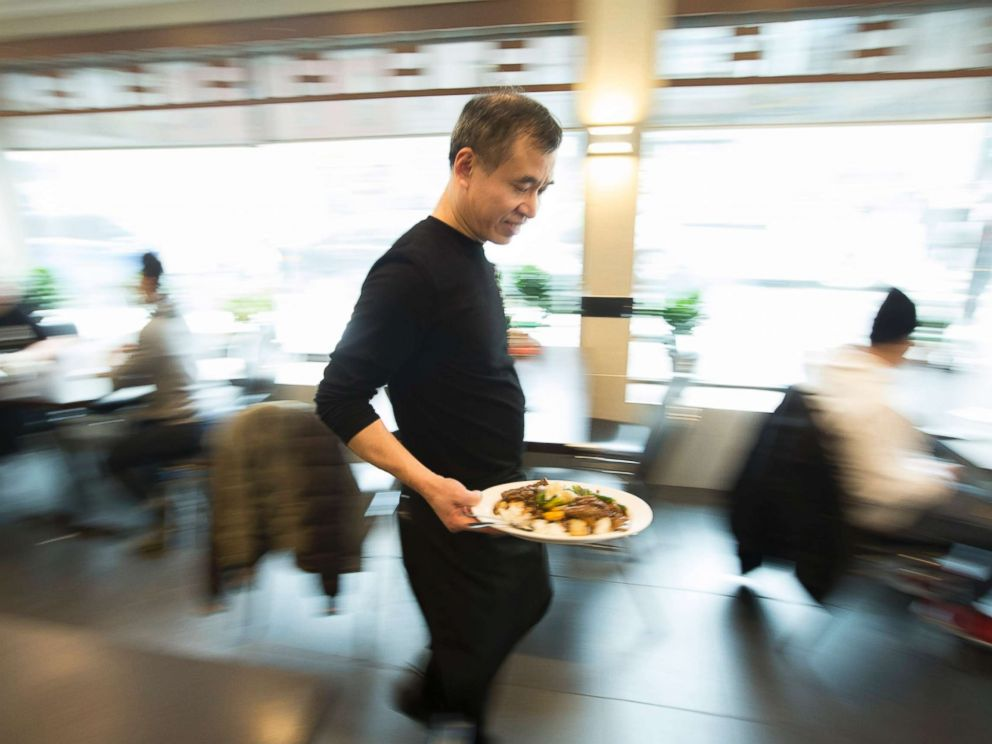 PHOTO: Employees help serve customers at Hong Shing restaurant in Toronto, Feb. 14, 2017.