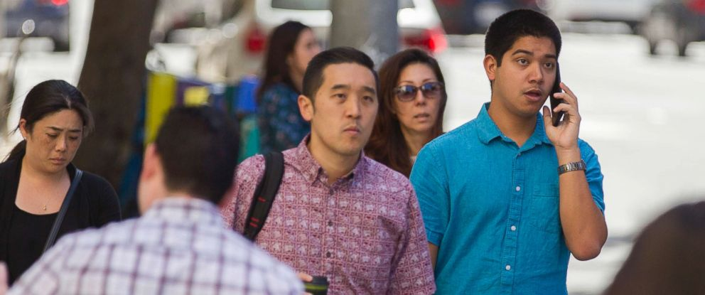 PHOTO: A pedestrian talks on his cell phone, Oct. 24, 2017 in Honolulu.