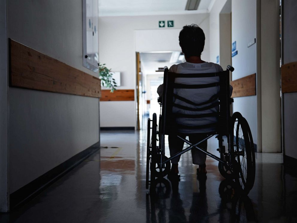 PHOTO: A woman in a wheelchair in what looks like a nursing home.