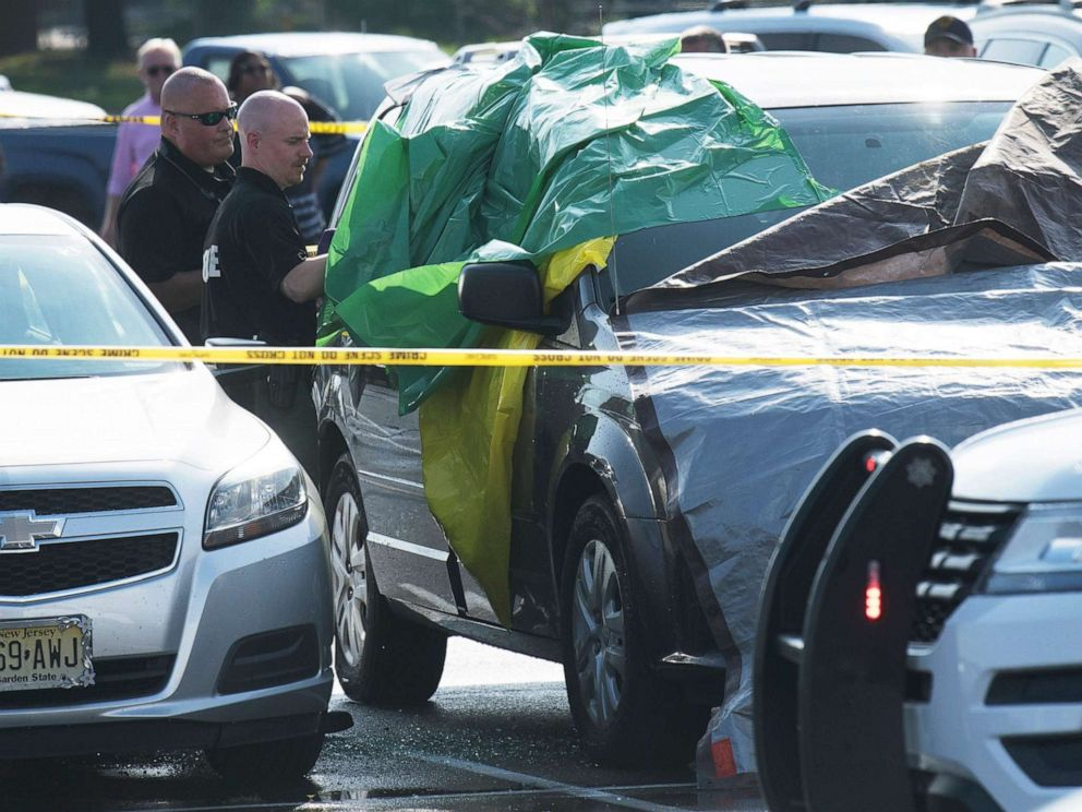 PHOTO: Authorities investigate the the death of a child found inside a vehicle in the parking lot of the PATCO Lindenwold Station, in Lindenwold, N.J., Aug. 16, 2019.