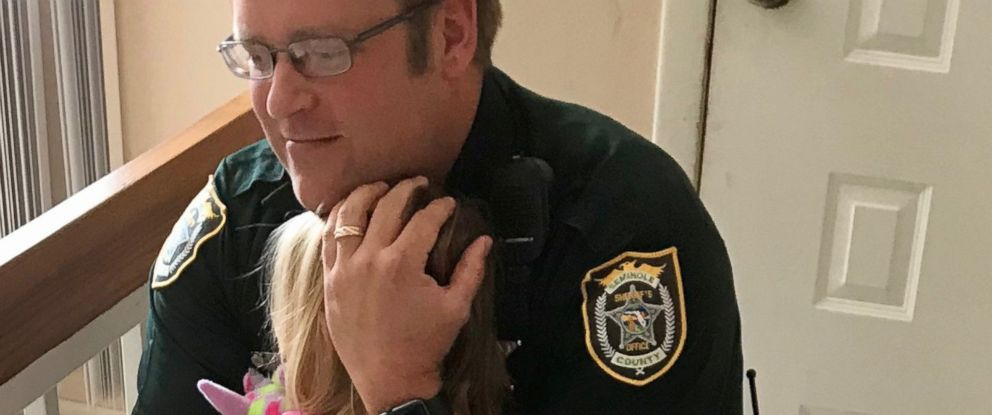 PHOTO: The Seminole County Sheriff's Office posted a picture on its Facebook page of Deputy Bill Dunn reuniting with a 3 year old girl, who he rescued after she left in a hot car, after she made a full recovery.