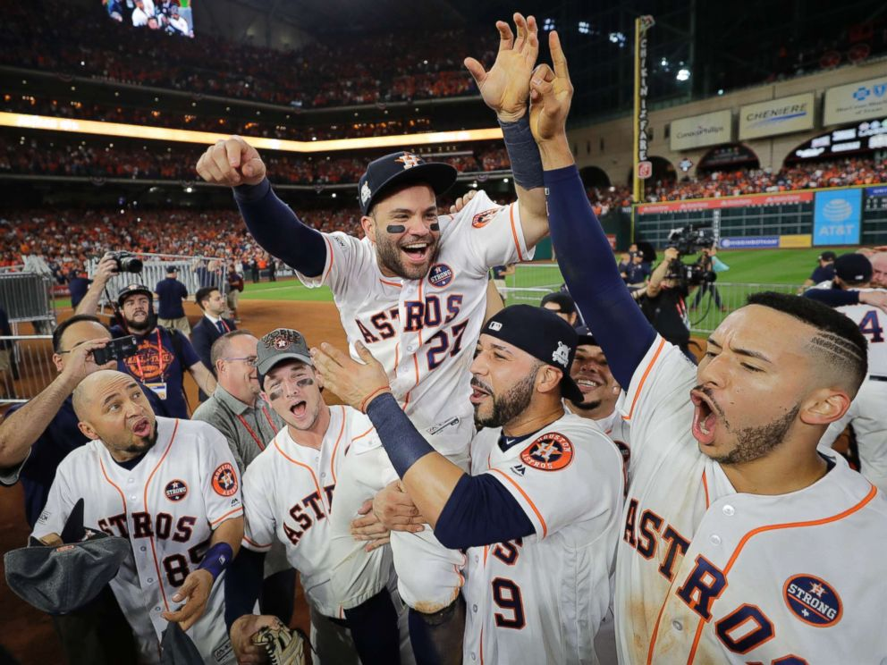 PHOTO: Houston Astros Jose Altuve is lifted by teammates after Game 7 of baseballs American League Championship Series against the New York Yankees, Oct. 21, 2017, in Houston.