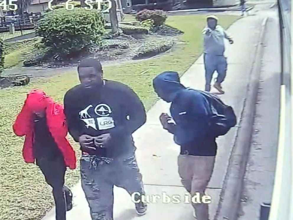 PHOTO: An unidentified gunman fires on three people in Houston on Nov. 4, 2018, in an image made from a video camera on a bus.