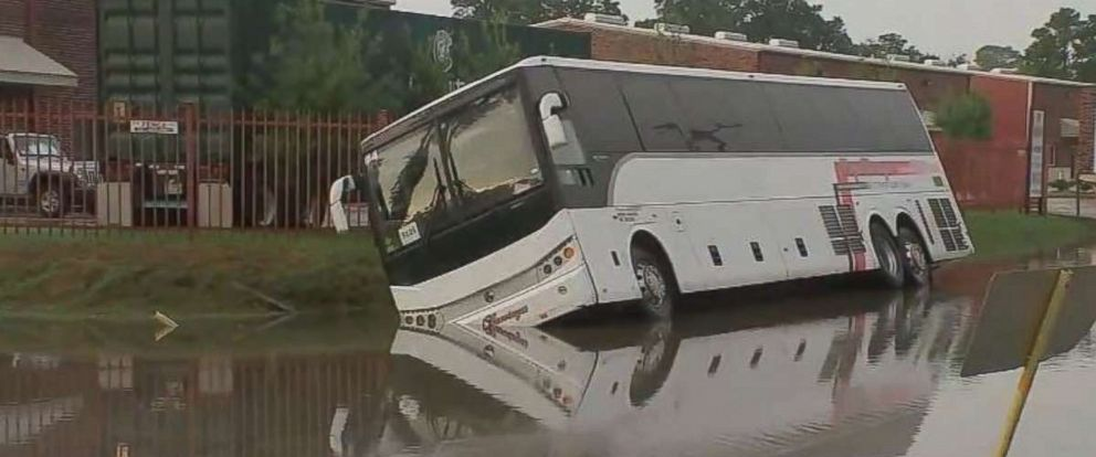 PHOTO: A charter bus carrying 34 people ran off the road and into a flooded ditch in Houston on Saturday, Sept. 22, 2018. Everyone was safely removed from the bus.
