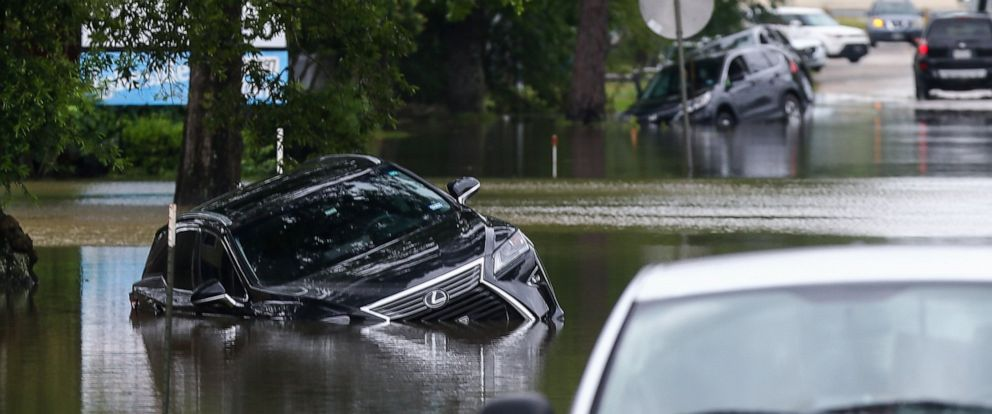 PHOTO: Vehicles remain stuck in the flooded E. Knox Drive following an overnight storm Wednesday, May 8, 2019, in Porter, Texas.
