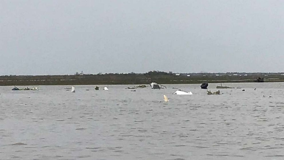 Debris from a Boeing 767 lies in Trinity Bay, near Anahuac, Texas, after it crashed Saturday, Feb. 23, 2019. Three people were on board and presumed dead.