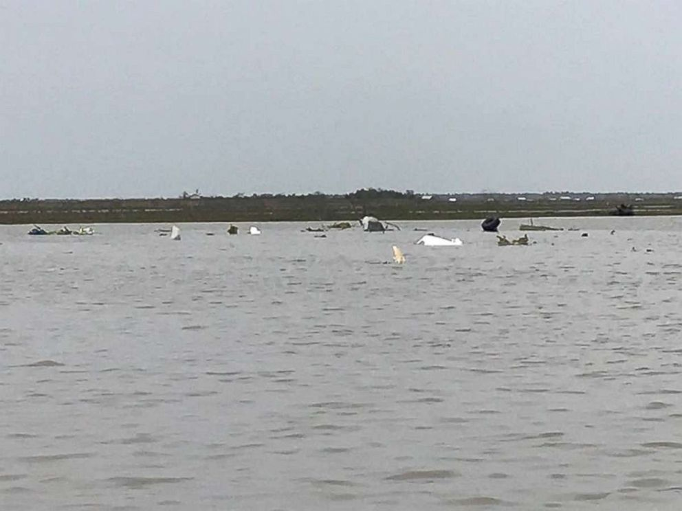 PHOTO: Debris from a Boeing 767 lies in Trinity Bay, near Anahuac, Texas, after it crashed Saturday, Feb. 23, 2019. Three people were on board and presumed dead.