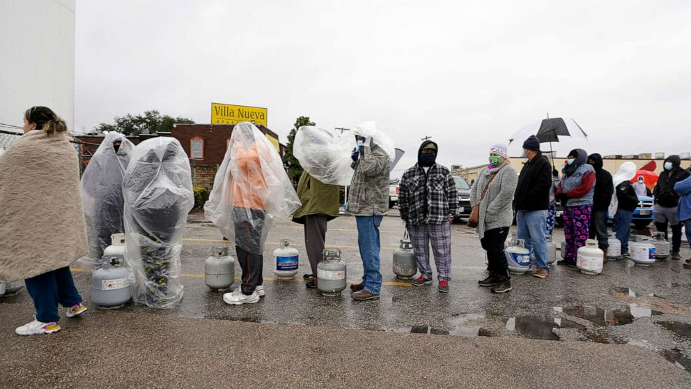 PHOTO: People wait in line to fill propane tanks, Feb. 17, 2021, during widespread power outages after a winter storm in Houston.