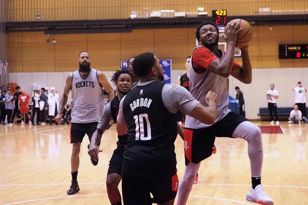 PHOTO: Houston Rockets guard Shamorie Ponds (R) tries to shoot over guard Eric Gordon (C) during a training session by the NBA basketball team in Tokyo on October 7, 2019. The Rockets are in Tokyo to play two exhibition matches this week.
