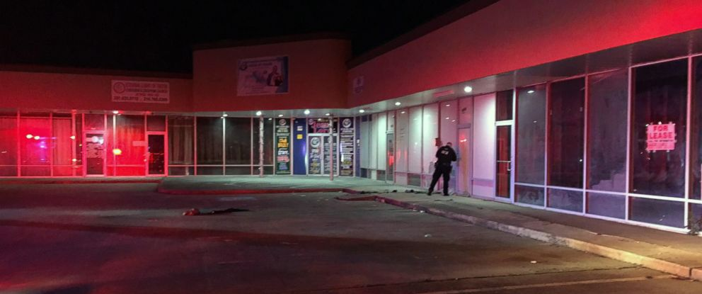 PHOTO: A police officer searches for evidence at the Star Plaza strip mall where the Houston Police say a homeless woman was set on fire on March 5, 2019, by an unknown assailant.