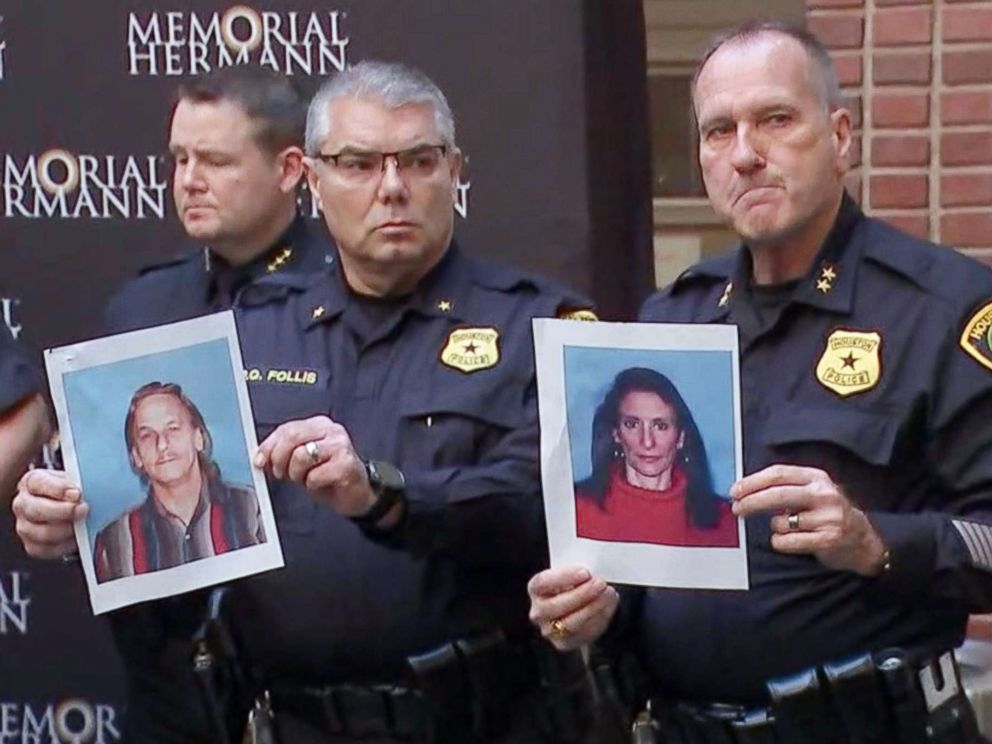 PHOTO: Houston police officers hold the photos of two suspects in the shooting of five police officers during a press conference at a hospital in Houston, Jan. 19, 2019. The suspects were identified as Dennis Tuttle, 59, and Rhogena Nicholas, 58.