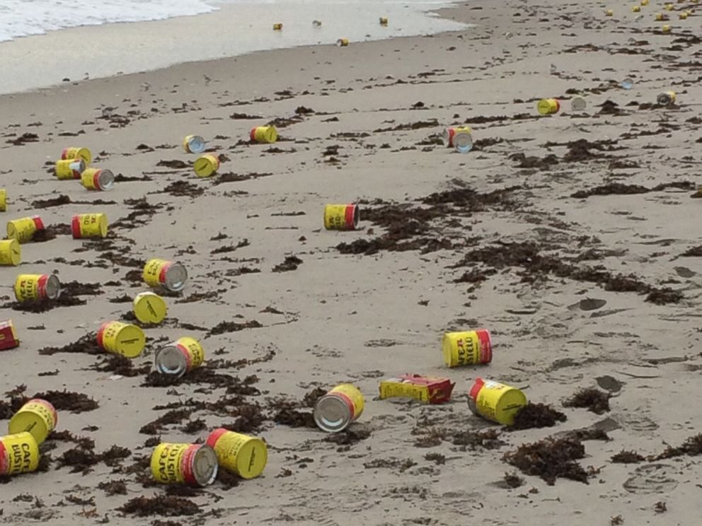 PHOTO: Hundreds of coffee cans mysteriously washed ashore a beach in Indialantic, Florida, on Dec. 8, 2015.