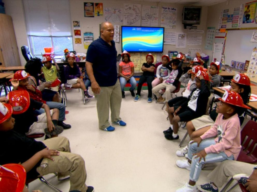 PHOTO: Ralph Heard returned to his former elementary school to teach students about fire safety. The Hartford Junior Fire Marshall Program, which trained Heard when he was 9, is celebrating its 70th anniversary.