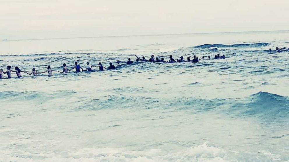 A group of strangers linked arms and waded into the ocean to rescue a group of swimmers stranded off the coast of Panama City Beach, Fla., July 8, 2017.