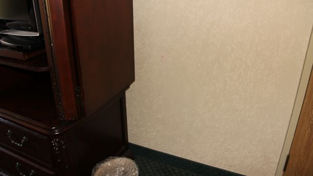 PHOTO: In a subsequent investigation of the Greg Flenikens hotel room, private investigator Ken Brennan and police detective Scott Apple found an indentation in the wall.