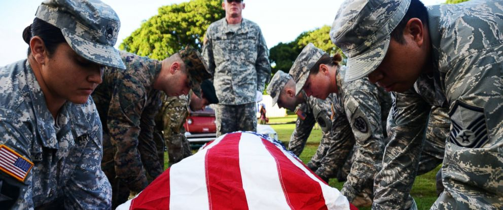 PHOTO: U.S. service members from the Defense POW/MIA Accounting Agency (DPAA) participate in a disinterment ceremony for the USS Oklahoma, Nov. 9, 2015, at the National Memorial Cemetery of the Pacific, Honolulu.