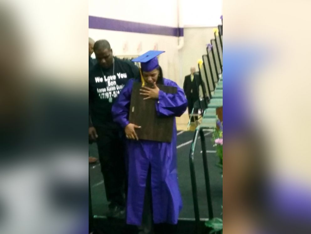PHOTO: Kaye Jackson receives her son Aaron Dunigans diploma in his honor.