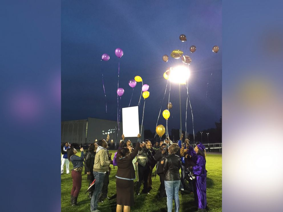 PHOTO: Aaron Dunigans family and teammates release balloons in his honor on graduation night.
