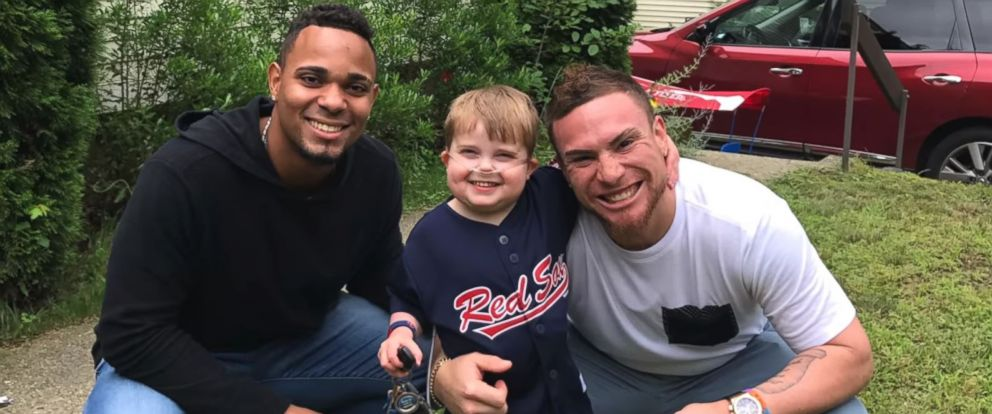 PHOTO: Ari Schultz is flanked by Boston Red Sox shortstop Xander Bogaerts (left) and catcher Christian Vasquez (right) in a YouTube video posted by the childs parents, the day he was rushed to the hospital and placed on life support.