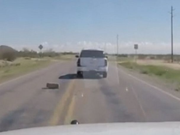 PHOTO: The Pinal County Sheriffs Office in Arizona posted a video to Facebook showing of bales of marijuana being thrown out a car window during a high-speed chase.