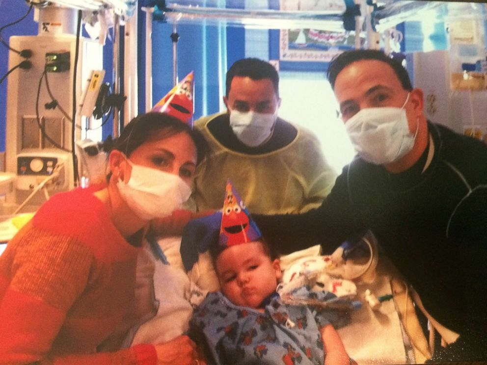 Art Estopinan, Jr., is seen here with family on his second birthday.