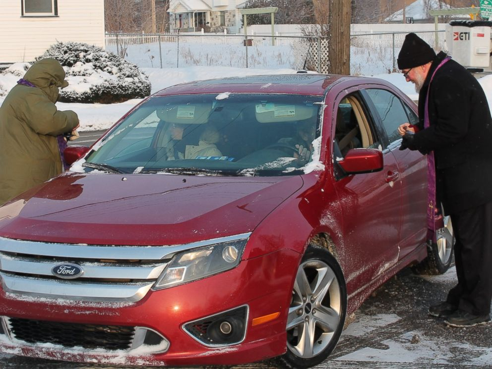 """PHOTO: All Saints Episcopal Church in Pontiac, Michigan, offered a """"Drive –Thru"""" Ash Wednesday service, Feb. 18, 2015, from 7:30 to 8:30 a.m."""