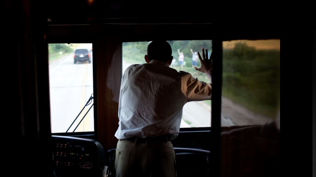 PHOTO:President Barack Obama waves to people along the road in Decorah, Iowa, Aug. 15, 2011, during a three-day bus tour in the Midwest focusing on ways to grow the economy.