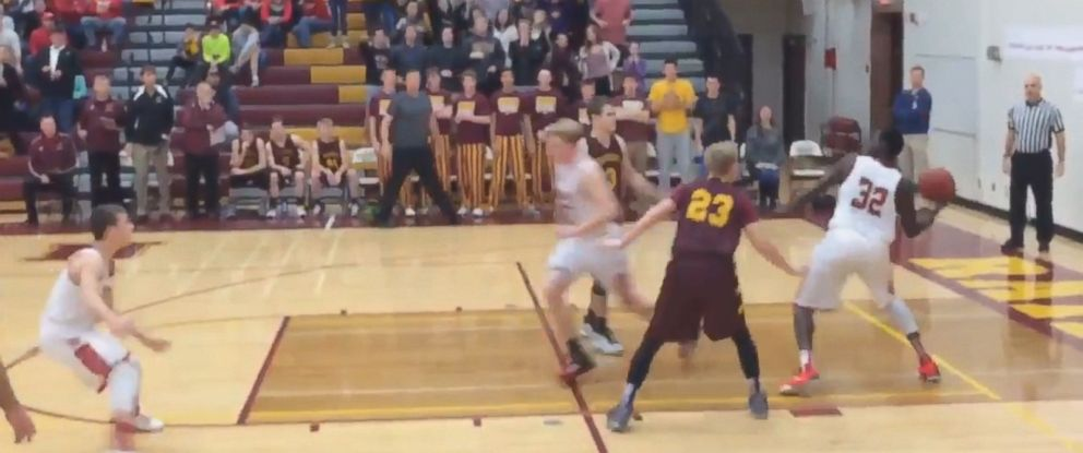 PHOTO: Basketball player Oman Oman for Austin High School in Austin, Minnesota scored a shot made from the other side of the court just before end-of-game buzzer rang on Dec. 8, 2015.