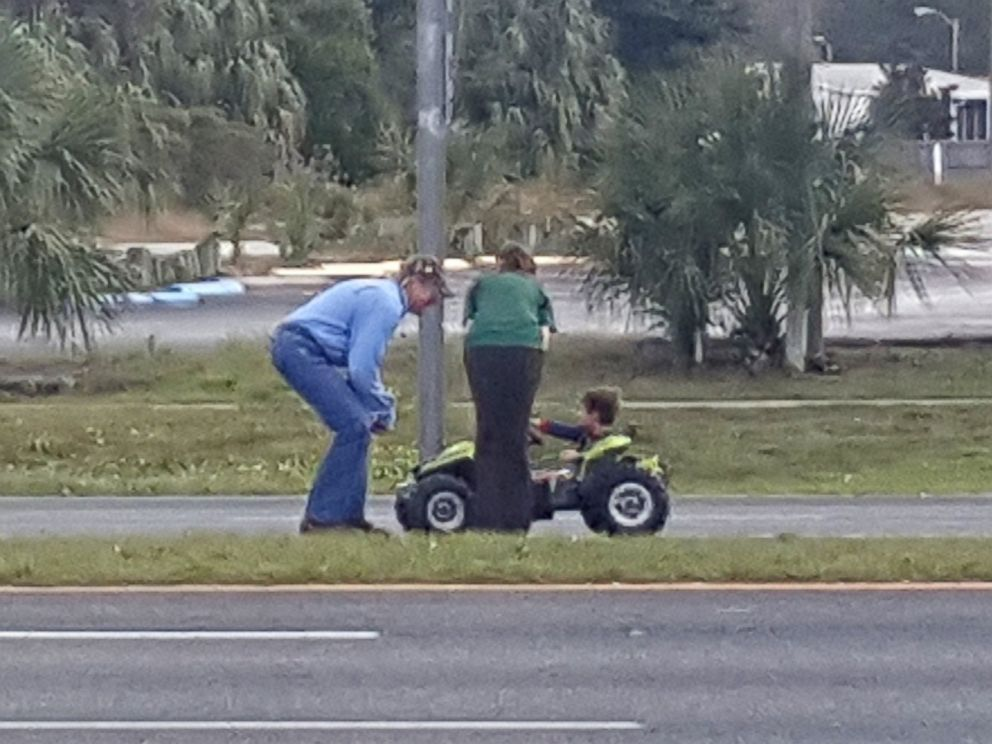 PHOTO: Bystanders formed a blockade around a 3-year-old boy who was found driving a motorized toy truck on a Florida highway on Jan. 6, 2015.