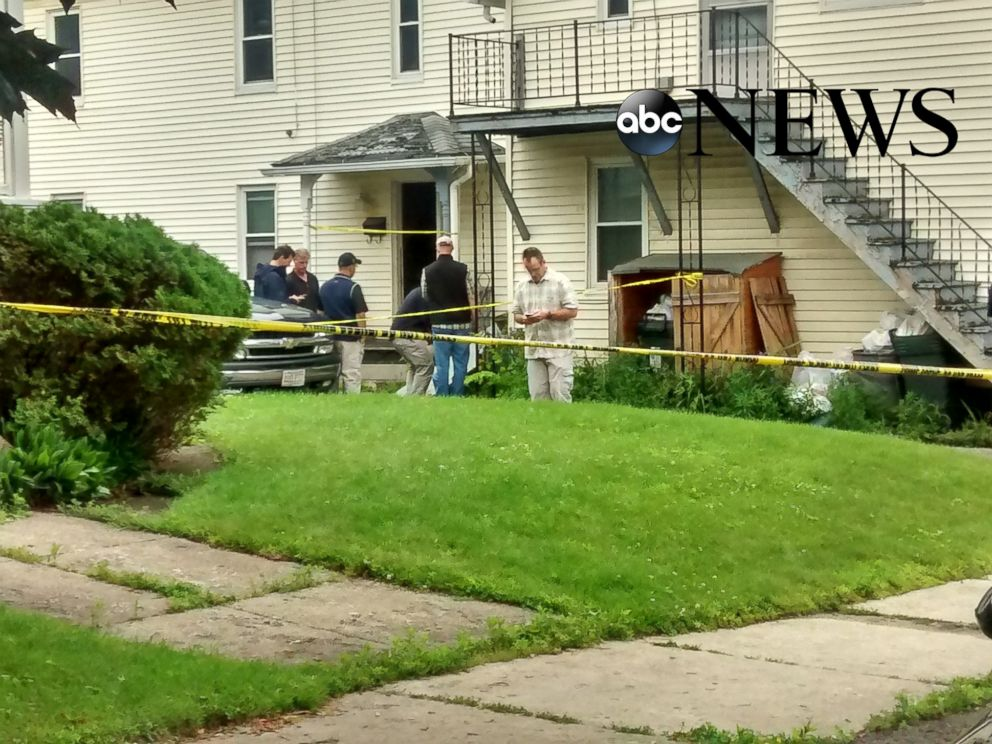 PHOTO: Federal agents search a home in Adams, Mass. on July 4.