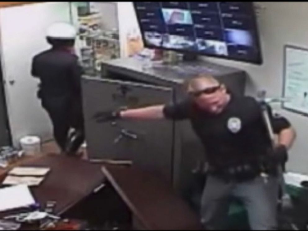 PHOTO: Surveillance video shows a raid conducted by Santa Ana police officers at an unlicensed marijuana dispensary.