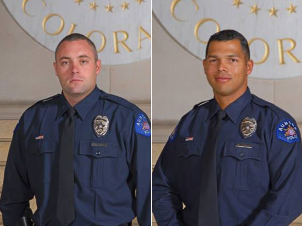 Aurora, Colo. police officers Craig Hess and Robert Little assisted Julia Brecht, 86, after her purse was snatched at a Target store.
