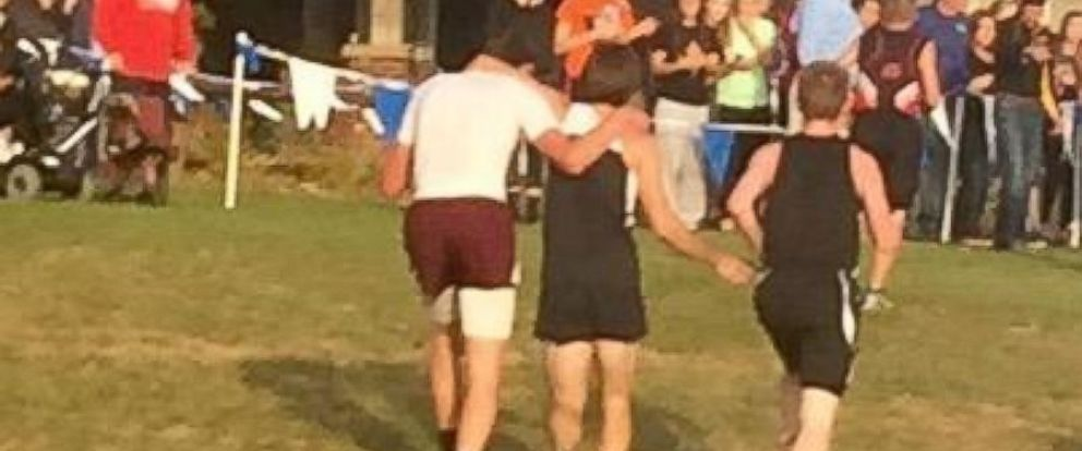 PHOTO: Iowa cross-country runner Zachary Houghland was disqualified from his meet last Thursday for helping rival runner Garret Hinson finish the race after he collapsed before the finish line.