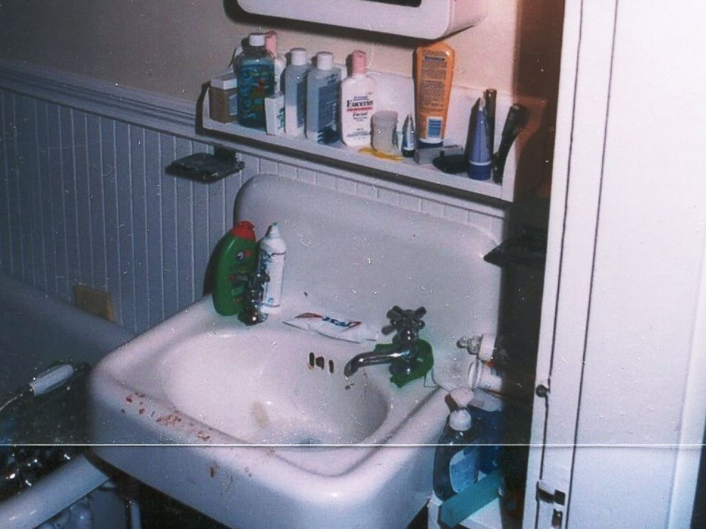Crime scene photo showing a sink with bloody fingerprints inside Christa Worthingtons home.